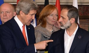 US secretary of state John Kerry speaks to the Syrian opposition's National Coalition chief Ahmed Moaz al-Khatib during the family photo of a meeting of the Friends of the Syria meeting in Rome.