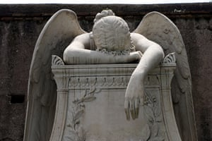 Ten best: Angel sculpture on a grave at the Protestant cemetery in Rome Italy