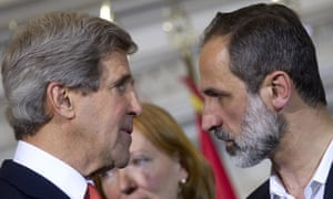 US secretary of state John Kerry talks with Syrian opposition leader Moaz Al-Khatib during a meeting in Rome.