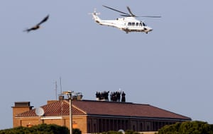 The Pope's last day: Priests wave as the helicopter carrying Pope Benedict XVI takes off