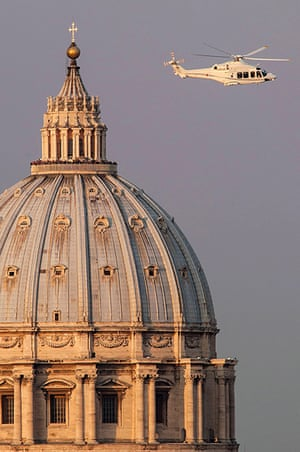 The Pope's last day: People crowd into the gallery on top of St Peter's Basilica