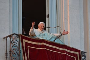 The Pope's last day: Pope Benedict XVI waves to faithful from a balcony in Castel Gandolfo