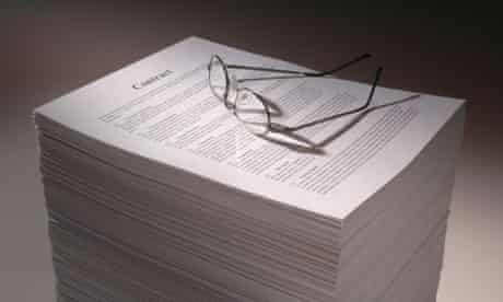 pile of contracts with glasses