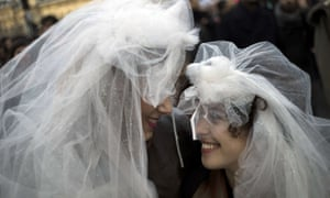 Women wed at Notre-Dame cathedral, Paris.