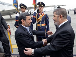 Egyptian president Mohamed Morsi greets Mahmoud Ahmadinejad at Cairo airport. It was the first visit by an Iranian head of state to Egypt in more than 30 years.