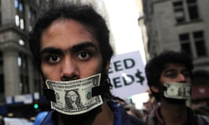 Members of Occupy Wall Street stage a protest