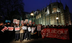 "Campaigners demonstrate for a ""yes"" vote to allow gay marriage, outside parliament in London."