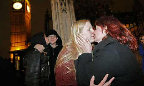 Elizabeth Maddison kisses her civil partner Hannah Pearson in front of parliament