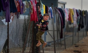 A Syrian boy at the Za'atari refugee camp in Jordan. The number of the refugees fleeing the conflict has topped 750,000 according to new figures from the UNHCR.
