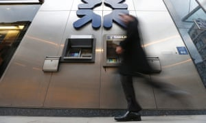 A pedestrian walks past a branch of the Royal Bank of Scotland (RBS) in the City of London.