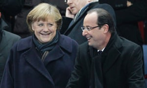 German chancellor Angela Merkel and French president Francois Hollande attend the international friendly soccer match between France and Germany at the Stade de France in Paris last night.
