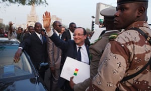 France's President Francois Hollande waves to a cheering crowd at Independence Plaza in Bamako, Mali
