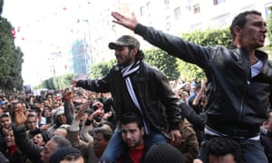 Two men on the shoulders of anti-government protesters in Tunis yesterday.