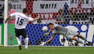 Jamie Carragher's career: Portuguese goalkeeper Ricardo saves from Jamie Carragher of England