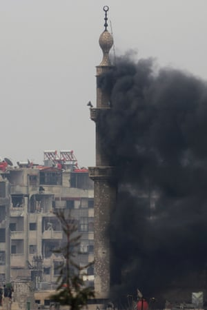 Smoke billows from a mosque tower during heavy fighting between the Free Syrian Army and government forces in the Jobar area of Damascus yesterday.