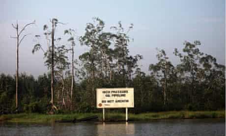 A warning sign belonging to Royal Dutch Shell along Nembe creek in Nigeria's oil state of Bayelsa