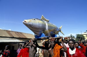 Coffins in Ghana: A fish shaped coffin is paraded through the streets of Accra