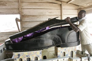 Coffins in Ghana: An undertaker opens a coffin, shaped like a shoe, in his showroom, Accra