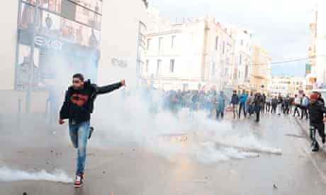 Tunisians protest outside the interior ministry in Tunis after Chokri Belaid's assassination