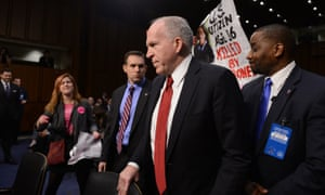Brennan confronts protesters at the Senate.