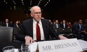 John Brennan takes his seat.