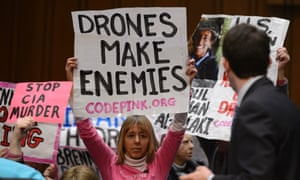 Anti-drone protesters hold signs before the start of the Senate intelligence committee hearing on the nomination of John Brennan as CIA directorl.