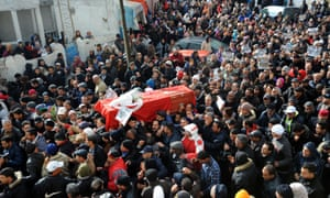People carry the coffin of late opposition politician Chokri Belaid during his funeral procession in Tunis on 8 February 2013.