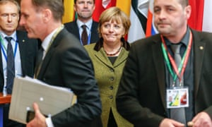 German Federal Chancellor Angela Merkel leaves for a two hours break during the European Council meeting, at the European Council headquarters in Brussels, Belgium, 08 February 2013.