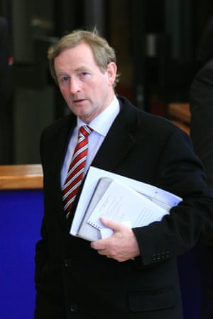 Ireland's Prime Minister Enda Kenny leaves for a break during an European Union leaders summit meeting discussing the European Union's long-term budget in Brussels February 8, 2013.