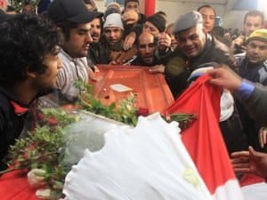Relatives of murdered opposition politician Chokri Belaid leave the house of his father while carrying the coffin prior to his funeral in Tunis on 8 February 2013.