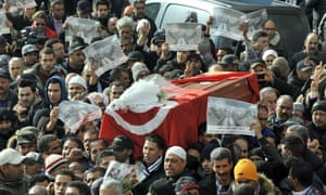 People carry the coffin of murdered opposition leader Chokri Belaid during his funeral procession in Tunis on 8 February 2013.