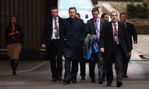 British Prime Minister David Cameron and his entourage arrive back at the EU Headquarters on February 8, 2013 in Brussels, Belgium.