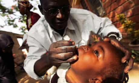 A Nigerian schoolgirl is vaccinated against polio in Kano, Nigeria