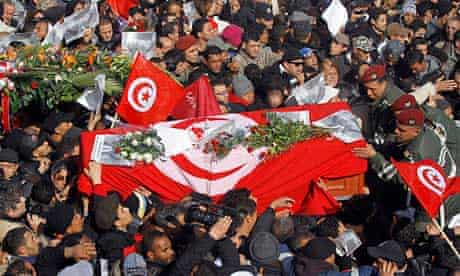 Tunisians carry the coffin of Chokri Belaid during his funeral procession in Tunis