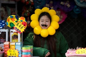 Lunar New Year: A vendor waits for customers at her stall at a temple fair in Ditan Park, Beijing