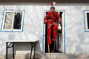 Lunar New Year: A Chinese folk artist prepares to perform during the opening ceremony of the Spring Festival Temple Fair at Dragon Lake Park in Beijing, China