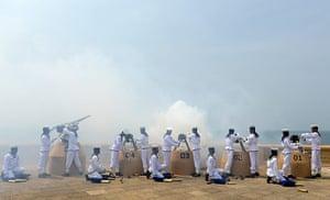 20 Photos: Sri Lankan Navy personnel fire a 21-gun