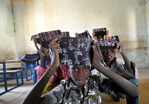 20 Photos: Students hold up thier chalk boards in Gao, Mali