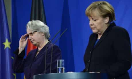 German chancellor Angela Merkel announces the resignation of education minister Annette Schavan