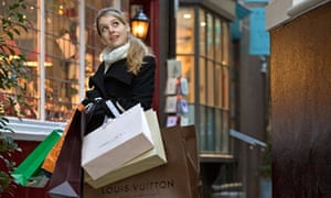 A young woman loaded with expensive shopping bags in London's West End