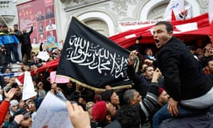 Supporters of Tunisia's ruling Ennahda party demonstrate in Tunis