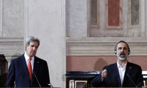Syrian opposition coalition leader Moaz al-Khatib, right, speaks as US secretary of state John Kerry listens during a press conference at Thursday's Friend of Syria meeting in Rome.