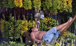A banana vendor takes a nap at his kiosk at Babakan market in Tangerang, Banten province, Indonesia. Inflation has hit a 20-month high after government measures to limit commodity imports pushed up consumer prices.