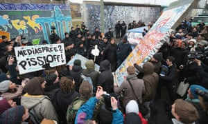 Protesters carry a styorfoam replica of a piece of the Berlin Wall to fill a gap created by construction workers in the East Side Gallery, which is the longest still-standing portion of the former Berlin Wall. A real estate developer is planning to build apartments between the Wall and the Spree River, and needs to remove a 25-meter long Wall section in order to allow access to the construction site.