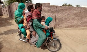 How many people can you fit on a motorbike? The entire family it seems as a man take his family fora spin in Rahim Yar Khan, southern Punjab province, India.