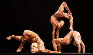 There are easier ways to look at your feet. Contortion artists perform during the Cirque du Soleil's Kooza show in Madrid, Spain.