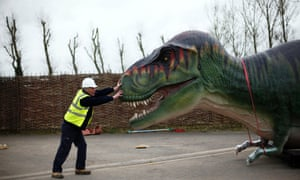 Will the safety hat protect him from the T-Rex? Construction manager Mel Tarplee pushes a Tyrannosaurus Rex at Twycross Zoo, England. Fifteen dinosaurs will go on display at Dinosaur Valley, a new attraction at the zoo.