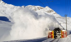 A snowblower removes snow from train tracks at the southern Swiss Bernina mountain pass.
