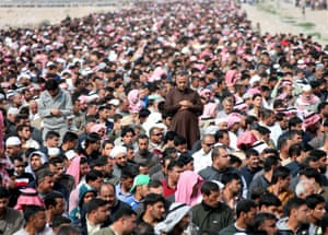 A general view shows Iraqi Sunni protesters praying during an anti-government demonstration in Fallujah city. Iraqi Sunni complained about injustice and marginalization, claiming that the Shiite-led Iraqi security forces were indiscriminately arresting their sons and torturing them.