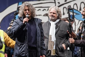 Gianroberto Casaleggio (L) and Beppe Grillo, leader of the Movimento 5 Stelle, Five Star Movement, attend at Piazza San Giovanni the last political rally before the national election on February 22, 2013 in Rome, Italy.